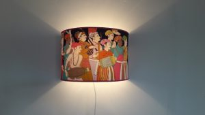 Applique murale demi-cylindrique dans un tissu Manuel Canovas